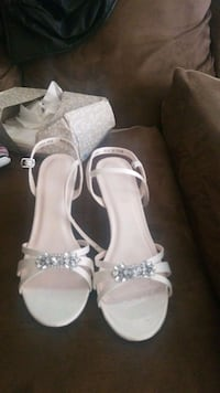 pair of white leather open toe ankle strap heels Des Moines, 50315
