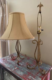 "Pair of sturdy metal lamps. Lamp base measures 25"" tall. One lamp shade measures 12"" tall x 16"" wide. Both are in excellent condition. Buy one for $18 or both for $25!! Potomac, 20854"
