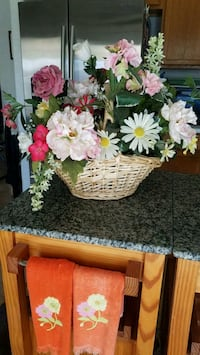 Large wicker basket silk flower arrangement