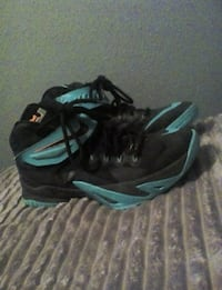pair of black-and-green Nike basketball shoes Cheyenne, 82007