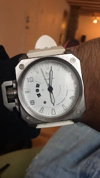 round silver-colored analog watch with white leather strap Montréal, H2L 3L6