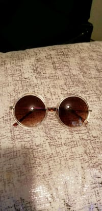 gold-colored framed aviator sunglasses