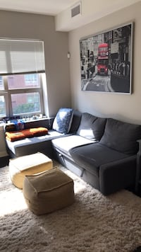 brown fabric sectional sofa with throw pillows West New York, 07086