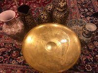 Round gold ceramic plate with other beautiful pieces  Springfield