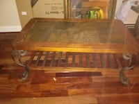 brown wooden framed glass top coffee table Hagerstown, 21740