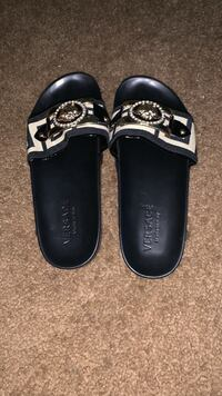 pair of black-and-white leather sandals St. Louis, 63111