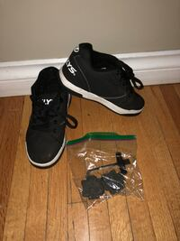 Pair of black-and-white Heelys sneakers Chilliwack, V2P 2L1