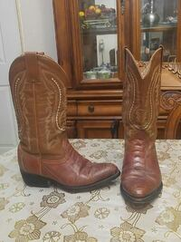 pair of brown leather cowboy boots Palmview, 78572