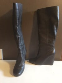 Pair of black knee-high leather wedge boots
