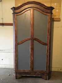 Brown and grey wooden Armoire Denver, 80224
