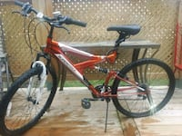 18 inch bicycle, mono shock and cut proof lock.