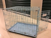 gray metallic folding dog crate