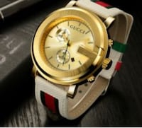 Gucci Watch/Gold face with white strap