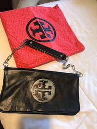 Authentic Tory Burch clutch sliver logo and chain with tag and bag   West Chicago, 60185