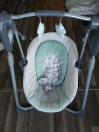 baby's green and white portable swing Baltimore, 21206