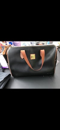 Dooney and Bourke purse with matching wallet. Genuine! From Dillards Little Rock