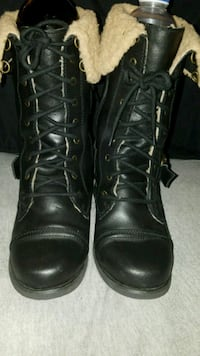 pair of black leather combat boots Herndon, 20171