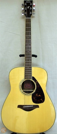 Like new brown and black yamaha acoustic guitar in for Yamaha policy