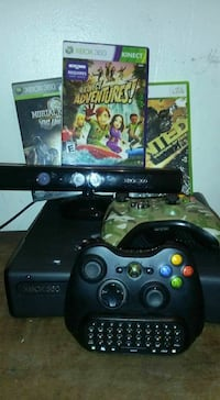 black Xbox 360 console with controllers and game c