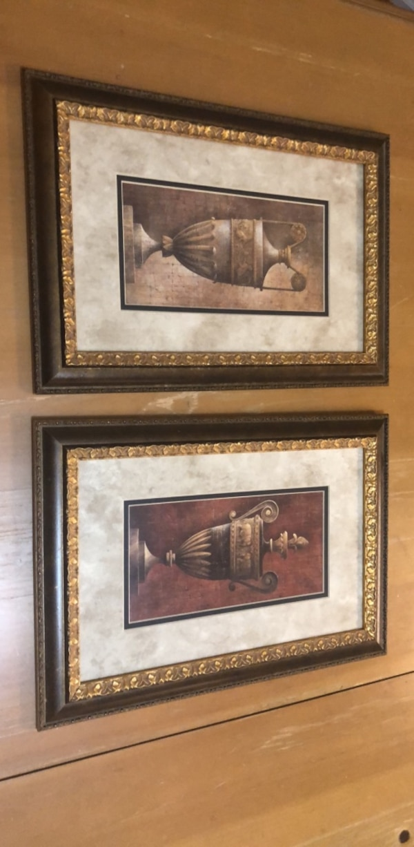 two brown wooden framed wall decors 7023a9b5-83c3-405d-97c2-0ccb3aa89314