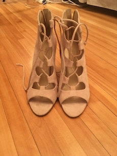 pair of white Nine West peep-toe strappy pumps