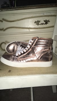 Pair of rose gold leather high-top sneakers Palm Bay, 32908