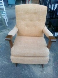 brown wooden framed beige padded glider chair Grand Rapids, 49505