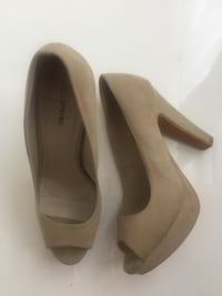 pair of beige peep-toe stilettos