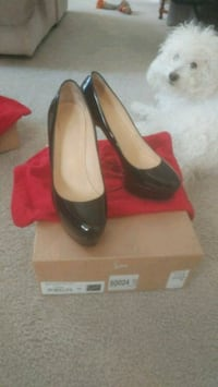pair of women's black patent leather almond-toe pl Rockville, 20851
