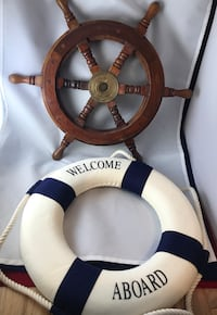 White and blue life ring and brown wooden ship's wheel decoration
