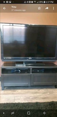 black flat screen TV with black wooden TV stand Vancouver, V5X 1N3