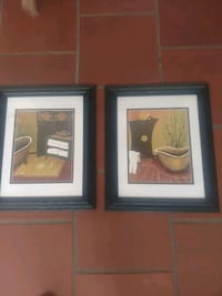 two black wooden framed painting of flowers 2405 mi