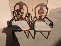 two brown wooden rocking chairs