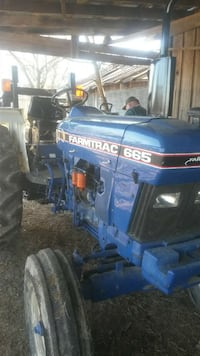 blue and black Farmtrac 665 tractor Bardstown, 40004
