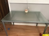 gray metal framed glass top table