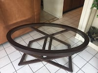 round brown wooden framed glass top table Austin
