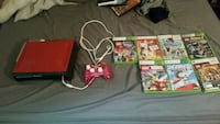 red Xbox 360 console with controller and game case 32 km
