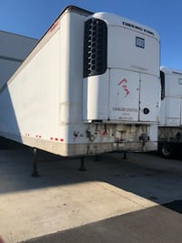 white and gray RV trailer 10 km
