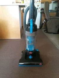 blue and black Bissell upright vacuum cleaner Prescott Valley, 86314