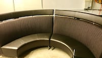 two brown leather padded chairs