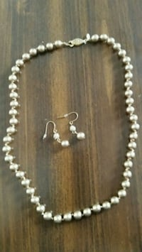 Gold colored pearl necklace with earrings  Homosassa