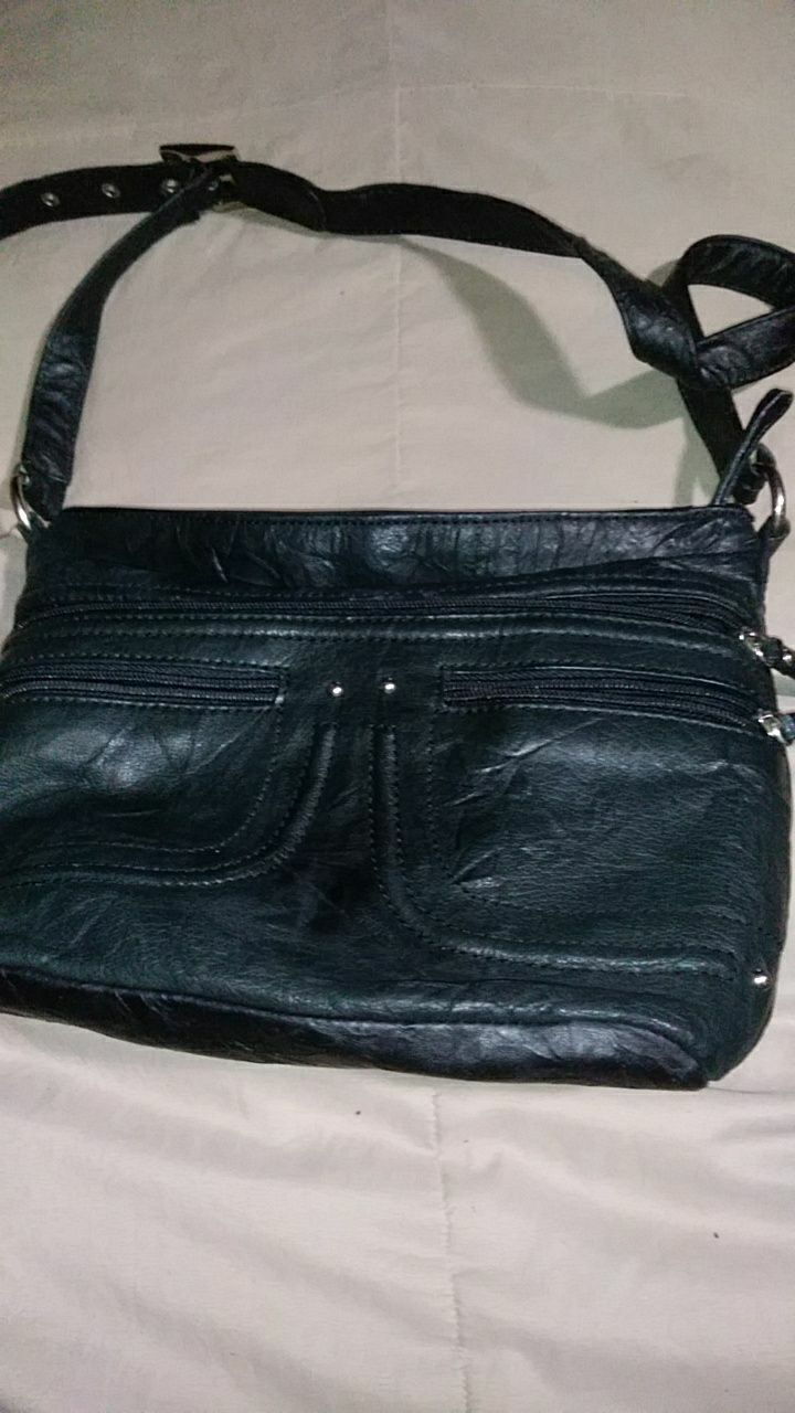black leather crossbody bag & Coleman vela 6 person tent in Akron - letgo