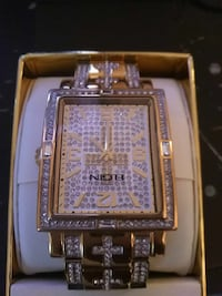 square gold analog watch with gold link bracelet West Palm Beach, 33401