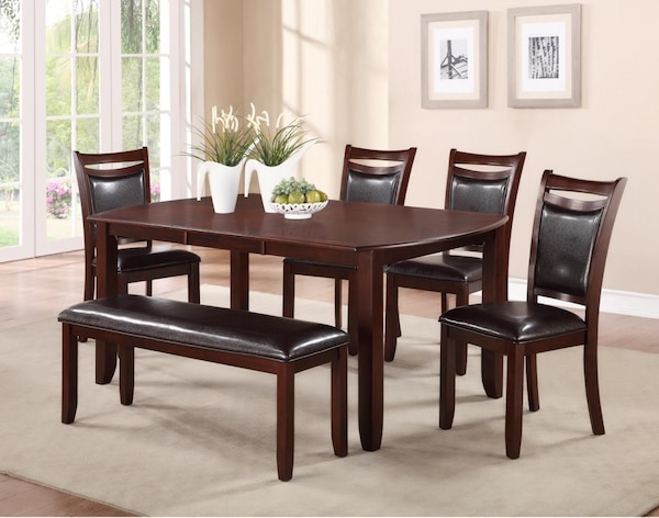 Dining table with four chairs and bench