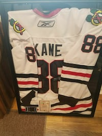white, black, and red Reebok 88 autographed jersey