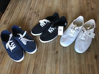 Three pairs of black and white shoes Laval, H7R 4V2