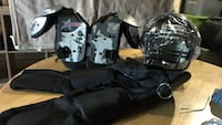 Gray shoulder pads and black football helmet Laurel, 20724