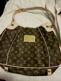 brown and beige Louis Vuitton leather backpack Southern Pines, 28387