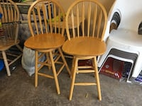 Two brown wooden barstools  6 km