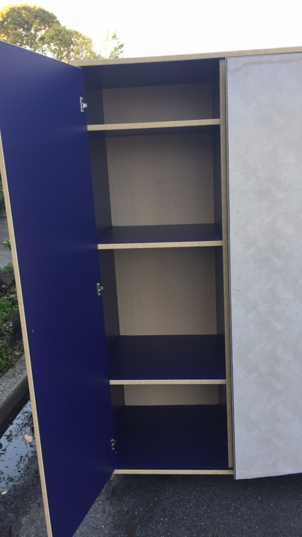 Shelf. armoire. Purple on the outside too. I covered it with contact paper which is easily removed. One of the legs broke while moving it but the other 3 legs can be removed so it can sit on the floor.